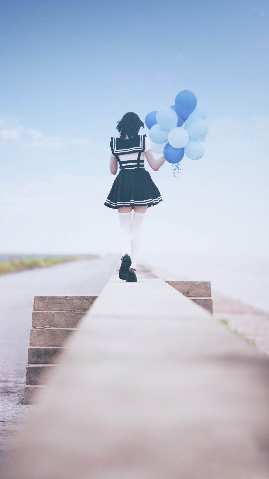School Girl with Blue Balloons
